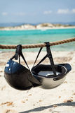 Helmets on the beach. Royalty Free Stock Images