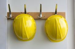 Helmets on coat hangers Royalty Free Stock Image