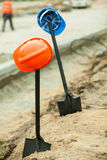 Helmets hanging on shovels. Close up of two helmets hanging on shovels Royalty Free Stock Photography