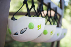 Helmets hanging on a wooden railing Stock Photos