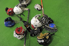 Helmets and hockey sticks Stock Image