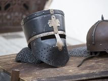 Helmets medieval of knights on a table.  Stock Photo