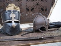 Helmets medieval of knights on a table.  Stock Images
