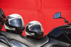 Helmets and motorcycle. Helmets Nolan and Suzuki motorcycle, Prague, September 24, Illustrative Editorial Royalty Free Stock Images