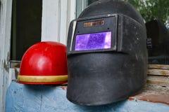Helmets. Old welding helmets after work Stock Images