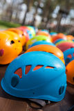 Helmets for rock climbers. Arranged in rows outdoor Royalty Free Stock Photography