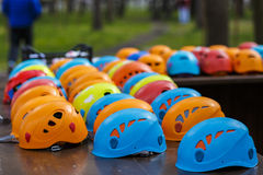 Helmets for rock climbers, arranged in rows Royalty Free Stock Photo