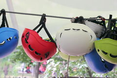 Helmets in a row. Colorful child-sized helmets hanging in a row. safety equipment Stock Photography