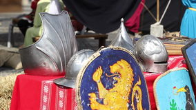Helmets and Shields. Medieval helmets and shields shining on a table stock video footage