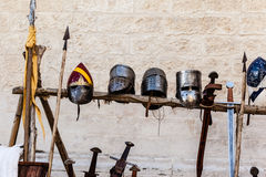Helmets and swords Royalty Free Stock Photography