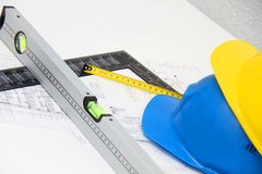 Helmets and tools for construction drawings and buildings Royalty Free Stock Photo