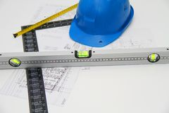 Helmets and tools for construction drawings and buildings Royalty Free Stock Photography