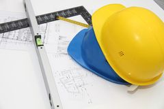 Helmets and tools for construction drawings and buildings Royalty Free Stock Images