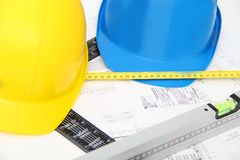 Helmets and tools for construction drawings and buildings Stock Image