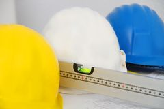 Helmets and tools for construction drawings and buildings Royalty Free Stock Photos