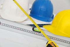 Helmets and tools for construction drawings and buildings Royalty Free Stock Image