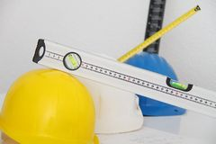 Helmets and tools for construction drawings and buildings Stock Images