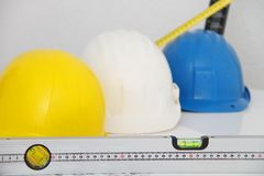 Helmets and tools for construction drawings and buildings Stock Photo