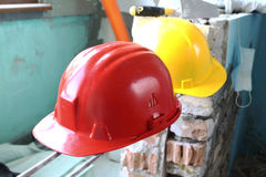 Helmets on workplace Royalty Free Stock Images