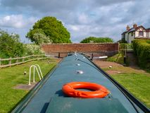 Narrowboat in canal lock. Helmsman view of a narrowboat in a canal lock in the upper position befor discharching the lock chamber. Picture taken on the Royalty Free Stock Photo