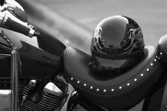 Helmut and motorcycle. Helmut and gloves on a seat of a cruser style motorcycle Stock Photography