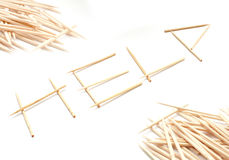 Help. Use wooden toothpicks to build a word Help stock image
