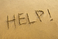 Help!. Stranded on the beach Royalty Free Stock Images