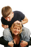 Help. A young man seating on a girl's shoulders Stock Photos