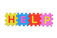 HELP. Letters-puzzle, word HELP,  isolated on white background Royalty Free Stock Photo