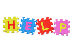 HELP. Letters-puzzle, word HELP,  isolated on white background Stock Image
