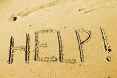 Help. Castaway message from uninhabited island beach - HELP Royalty Free Stock Photos