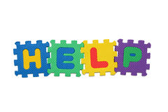 HELP. Word HELP, from letter puzzle, isolated on white background Royalty Free Stock Images