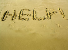 """Help!. Inscription """"Help!"""" on the sea sand Royalty Free Stock Images"""