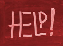 Help. The word Help written with chalk on a blackboard Stock Photos