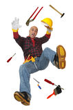 Help. Construction worker falling with tools isolated in white Royalty Free Stock Photography