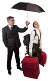 Help. Man with umbrela Help a young woman to carry the Luggage Royalty Free Stock Photos