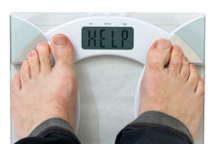 Help!!!. Man on the weight scale with help sign on the display Royalty Free Stock Image