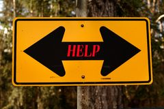 HELP. Two-way road sign with the word help written across the middle Stock Image