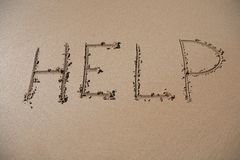 Help. The word Help written in the sand on a beach Royalty Free Stock Photos