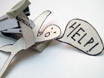 HELP!. Paper figure crying for help Royalty Free Stock Photography