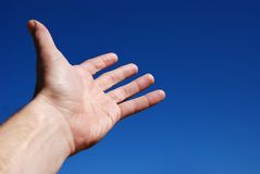 Help. Hand Reaching to the Blue Sky royalty free stock images