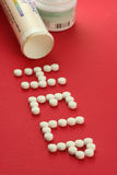 Help. Pills forming the word help Royalty Free Stock Photography