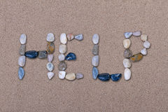 Help. Written with Pebbles on Sand Royalty Free Stock Photography