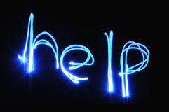HELP. Hand written in blue light Royalty Free Stock Images
