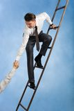 Help. Conceptual image of successful businessman standing on ladder and giving hand to his partner Stock Photos