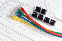 IT help, assistance, network cables circuit board background Royalty Free Stock Photo