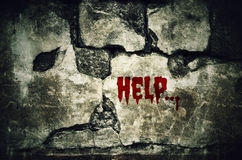 Help bloody on dirty brick wall with vintage and vignette tone - Stock Photography