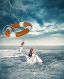 Help businessman falls Royalty Free Stock Photo