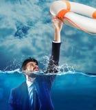 Help businessman falls Royalty Free Stock Image