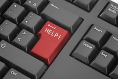 Help Button. A red help button on a keyboard Royalty Free Stock Photo